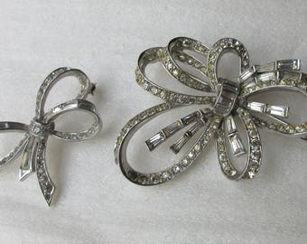 Two 1950s MARCEL BOUCHER Clear Rhinestone Ribbon Bow Form Brooches, Signed and Numbered, Phrygian Cap