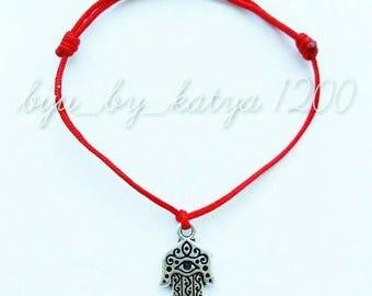 Red string bracelet with hamsa