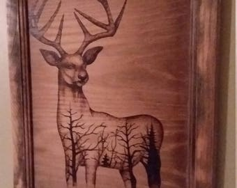Wood burn deer with trees picture