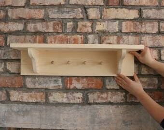 Handmade wooden peg shelves