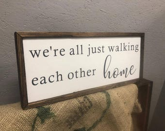 We're all just walking each other home sign