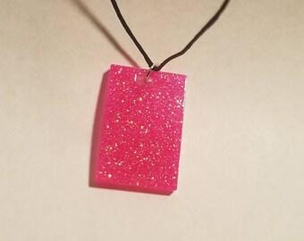 Pink glitter rectangle resin pendant