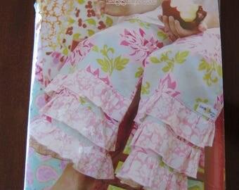 NIP Portabello Pixie Ruffle Pants Sewing Pattern by Sandi Henderson UNCUT sz 6 mo thru 8