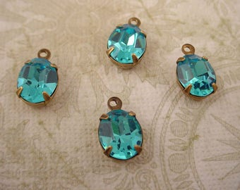 4 Vintage Swarovski  glass aqua aquamarine oval 10x8  in brass ox Prong Settings 1 Rings Closed Backs
