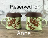 RESERVED FOR ANNE: 2 pow!!! mugs - Diner mugs with brown silicone lids.  Porcelain mugs with light green glaze. Pow and stars imagery