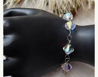 ChristmasInJulySALE..... Sale......One of a Kind Handcrafted .925 Sterling Silver and Multi Faceted AB Crystal Bracelet