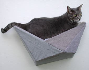 Geometric bed cat wall shelf in textured shades of light grey