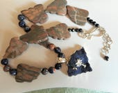 Midnight on Key Largo ... pendant necklace, dark blue druzy pendant, Canyon Marble carved leaf beads, orange sodalite ... #788