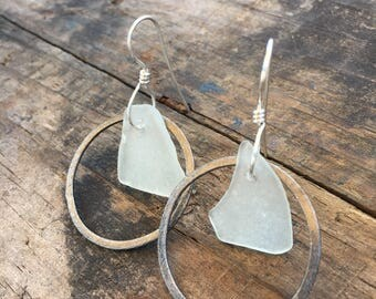 pale green sea glass earrings with oxidized circle and bright silver ear wire