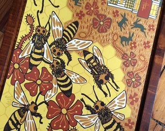 Honeybee colorful woodcut, block print, framed in curly maple wood