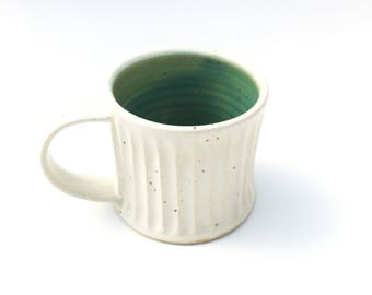 Handmade pottery stoneware mug 12 ounce in alabaster white and copper