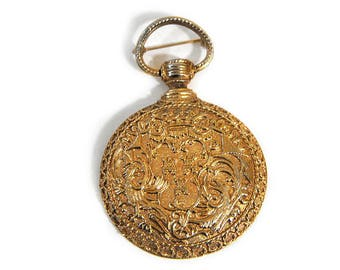 1980s Geno Richelieu Oversized Ornate Gold Tone Metal Embossed Medal Style Vintage Pin Brooch