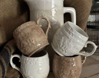 White Ironstone pitcher and 4 cups with crackle and staining.