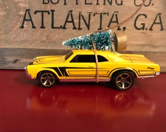 Pontiac GTO Carrying Christmas Tree Ornament