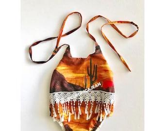 On sale! Southwestern desert sunset fringe lace romper with snaps.