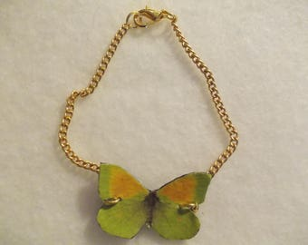 Green and yellow leather bracelet with butterfly