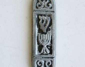 A vintage aluminum  mezuzah made in Israel.