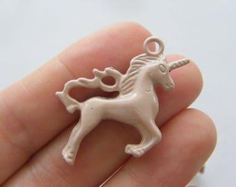 4 Unicorn charms pinkish tone A661