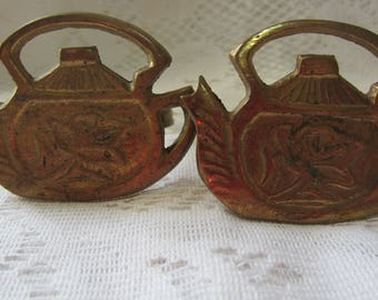 Two Brass Napkin Rings in the Shape of Teapots