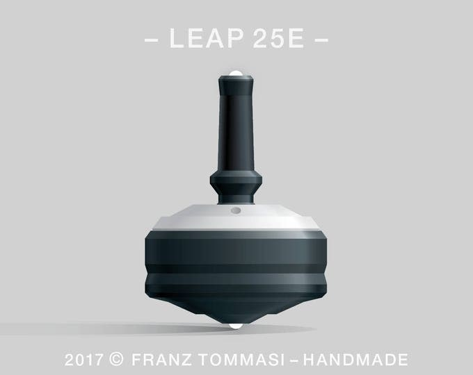LEAP 25E White-on-Black Spin Top with rubber grip, dual ceramic tip, and accent holes (3)