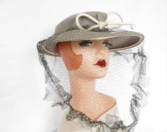 1940s woman's hat, vintage gray with black veil. WW2 era