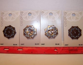 Four cutout buttons in cocoa brown 32 mm or 1 1/4 inches