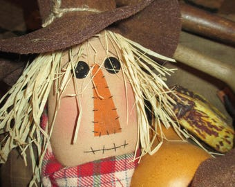 Scarecrow Ornie Tuck with red scarf