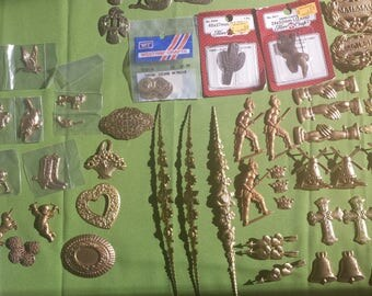 Pressed metal figures for embellishing stained glass, wood and fabric