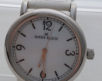 Anne Klein MOP Large face White Face and White Band watch Silver, New battery, Model Y121E