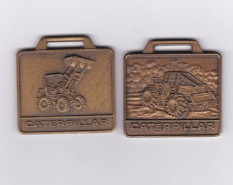 Two Caterpillar Pocket Watch Fobs
