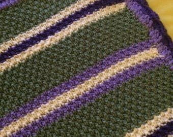 green, purple and white baby blanket
