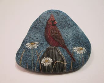 Cardinal and Daisies hand painted on a rock by Ann Kelly