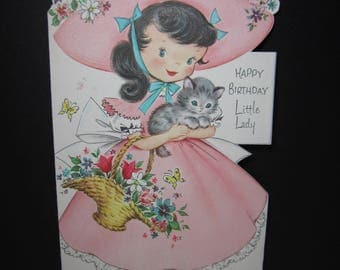 Adorable 1950's embossed die cut Fairfield birthday card  little girl dressed in pink bonnet matching dress,holds kitten and flower basket