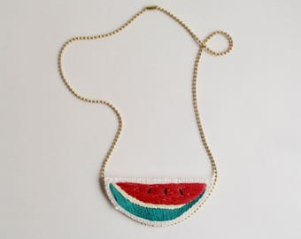 Embroidered watermelon necklace stitched on cream muslin with cream felt backing and matte gold tone ball chain summer jewelry