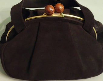 1940s brown Koret hand bag with large lucite ball clasps
