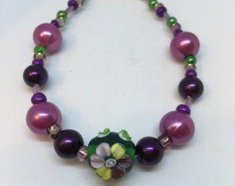 Bracelet Handmade Purple and Green Glass Lampwork Bead Flower by JulieDeeleyJewellery on Etsy