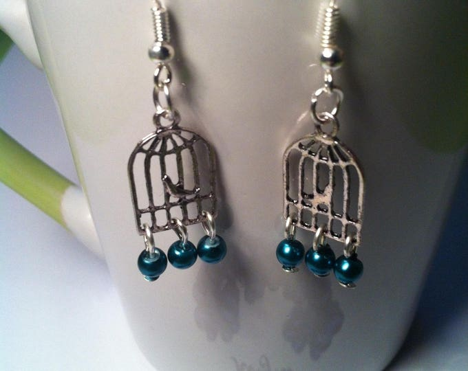 Earrings cages birds and tiny green beads