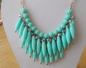3 Row Bib Necklace with Turquoise Color Pendants and Clear Crystal Beads on a Gold Tone Chain