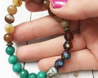 Bohemian, brown striped agate, fire polished crystal and teal green beaded elastic Buddha bracelet by Jules Jewelry Box