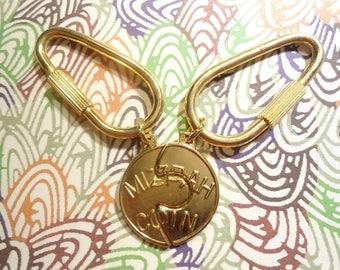 1 Set of Goldplated Miz-Pah Coin Key Rings