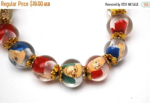 Vintage Lucite bead  Stretch Bracelet. - Fun colorful Caricature man face - Buddha  - vintage Beads mid century