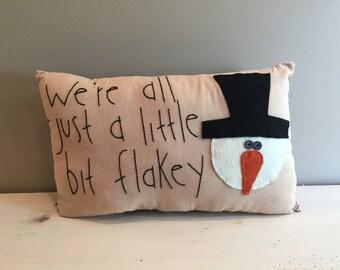 We're all just a little bit flakey snowman pillow