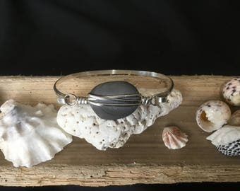 """Cape Cod beach stone in sterling silver bracelet.  Measures 7 1/4"""" around."""