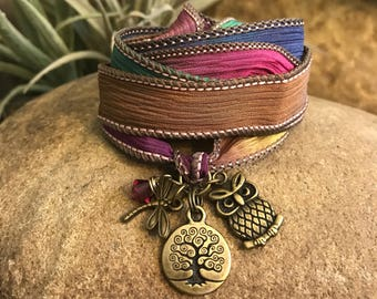 Tree silk wrap bracelet with rainbow silk ribbon, crystal, owl charm, and dragonfly. Great gifts for yoga enthusiasts