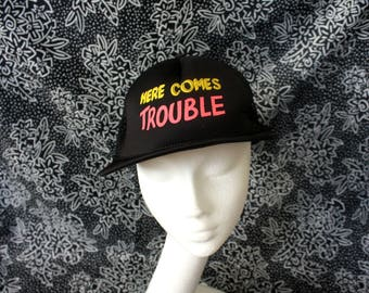 Retro Here Comes Trouble Snapback Mesh Hat. Black Neon Novelty Snapback Mesh Baseball Cap. Troublemaker Funny Hipster Dude Trucker Hat