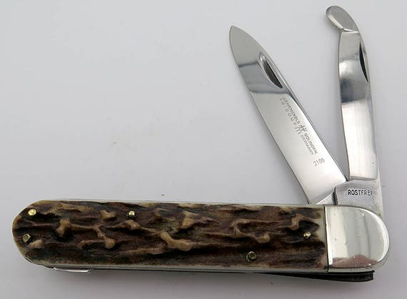 Rare Large 4.5 inch closed JA Henckels, Solingen, Germany. Lock back Stag Knife. Has a wood Plane Blade. This is an heavy Mint knife
