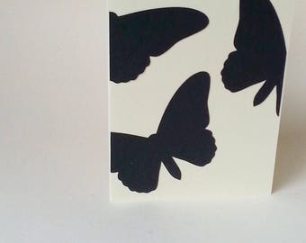 "The ""Black butterflies in flight"" card with its envelope"