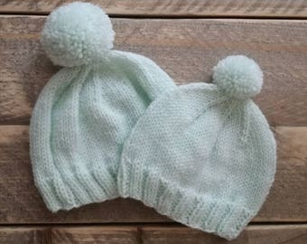 Knitted light mint green baby hat
