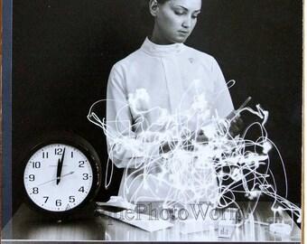 Beautiful nurse w syringe clock and light effects vintage art photo by Loebel