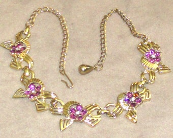 Necklace goldtone five links with amethyst rhinestones